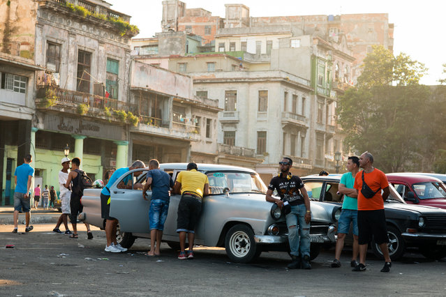 Taxi drivers are pictured soliciting business in the Old Havana Neighborhood. (Photo by Sarah L. Voisin/The Washington Post)