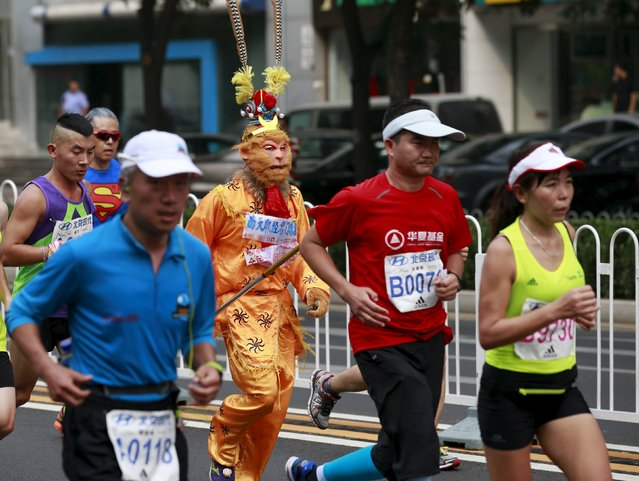 """A participant runs while dressed as the Monkey King, a character from the Chinese classical novel """"Journey to the West"""", during the Beijing International Marathon in Beijing, China, September 20, 2015. (Photo by Kim Kyung-Hoon/Reuters)"""