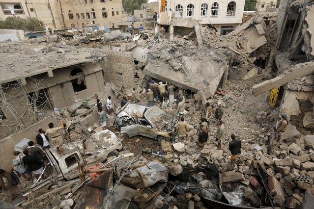 People gather at the site of a Saudi-led air strike in Yemen's capital Sanaa September 21, 2015. (Photo by Khaled Abdullah/Reuters)