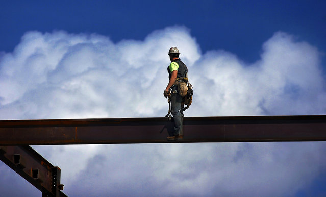 A steel worker takes a moment to enjoy the view during construction of The Learning Commons building, Tuesday, October 7, 2014, at Marywood University in Scranton, Pa. The $35 million, 72,00 square feet structure is due for completion in 2015. (Photo by Butch Comegys/AP Photo/Scranton Times & Tribune)