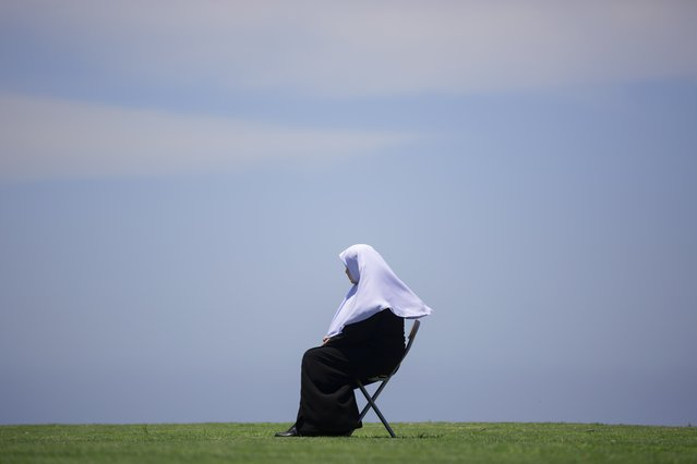 An Israeli Arab woman attends Friday prayers next to an 18th century Muslim burial ground ahed of a protest against the decision made by the Tel Aviv-Jaffa Municipality to demolish the burial ground and build shelter for homeless people, in Tel Aviv, Israel, Friday, June 12, 2020. (Photo by Oded Balilty/AP Photo)