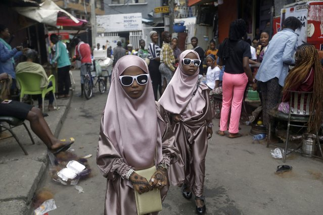 "Muslim girls are seen after prayers, in Lagos, Nigeria, Friday, July 31, 2020. Small groups of pilgrims performed one of the final rites of the Islamic hajj on Friday as Muslims worldwide marked the start of the Eid al-Adha holiday amid a global pandemic that has impacted nearly every aspect of this year's pilgrimage and celebrations. The last days of hajj coincide with the four-day Eid al-Adha, or ""Feast of Sacrifice"", in which Muslims slaughter livestock and distribute the meat to the poor. (Photo by Sunday Alamba/AP Photo)"