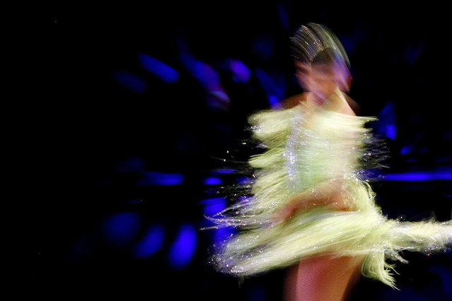 A picture taken with slow shutter speed shows Emily Vaca performing in the finals of the Tenth World Salsa Festival in Cali, Colombia, 04 October 2015. (Photo by Christian Escobar Mora/EPA)