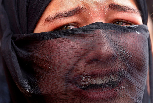 A girl mourns during the funeral of Aaquib Gul, who according to local media, was killed in a gun battle with Indian security forces at the Radbugh Village of Budgam District, in Srinagar July 12, 2017. (Photo by Danish Ismail/Reuters)