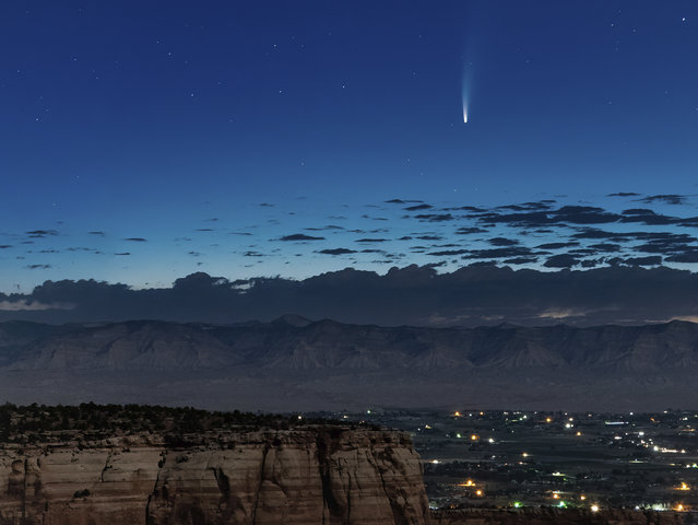 Comet Neowise soars in the horizon of the early morning sky in this view from the near the grand view lookout at the Colorado National Monument west of Grand Junction, Colo., Thursday, July 9, 2020. The newly discovered comet is streaking past Earth, providing a celestial nighttime show after buzzing the sun and expanding its tail. (Photo by Conrad Earnest via AP Photo)