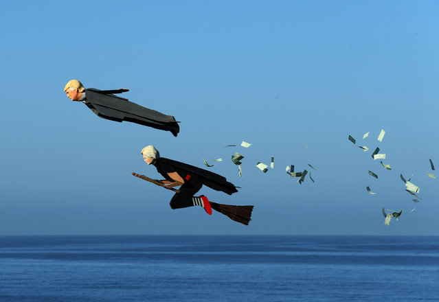 Model plane builder Otto Dieffenbach III makes his remote control plane resembling U.S. Presidential candidate Donald Trump release fake money as it flies over the beach next to a similar plane resembling Hillary Clinton in Carlsbad, California, U.S. September 15, 2016. (Photo by Mike Blake/Reuters)