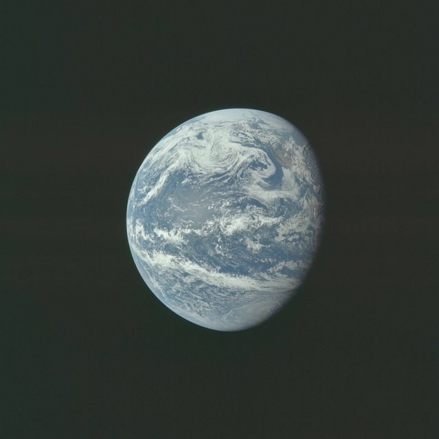 The earth is pictured as photographed from 10,000 nautical miles away during the Apollo 11  mission in this July 16, 1969 NASA handout photo. (Photo by Reuters/NASA)