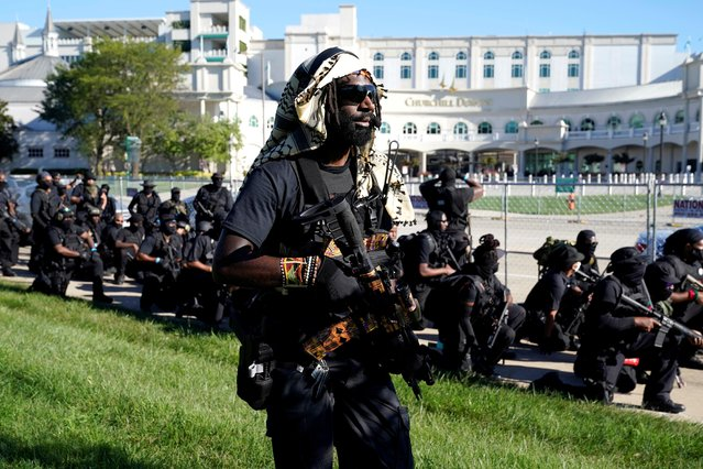 Members and supporters of an all-black militia group called NFAC hold an armed rally outside Churchill Downs in Louisville, Kentucky, U.S. September 5, 2020. (Photo by Bryan Woolston/Reuters)