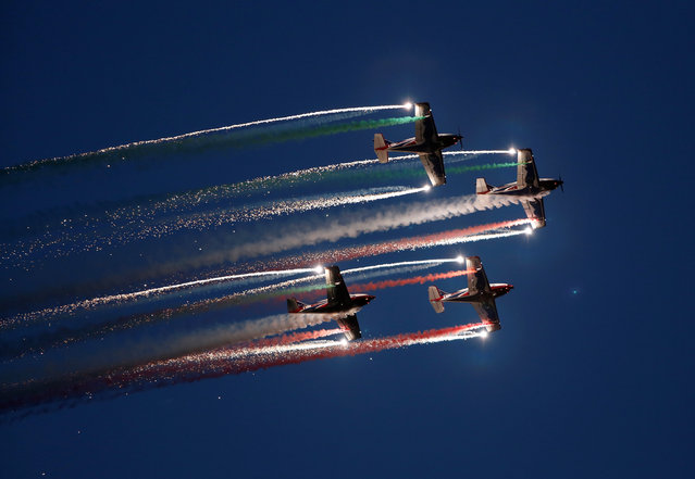 The Pioneer Team, a civil aerobatic team from Italy, let off pyrotechnics from their Pioneer 330 aircraft during the Malta International Airshow off SmartCity Malta, outside Valletta, Malta, September 24, 2016. (Photo by Darrin Zammit Lupi/Reuters)