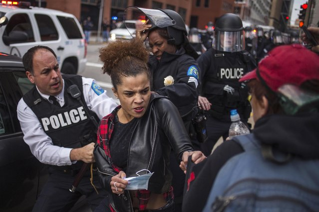 A protester (C) demanding justice for Michael Brown tries to hold on to a fellow protester (R) as she is detained by police in riot gear for disrupting traffic in downtown St. Louis, Missouri November 30, 2014. Officer Darren Wilson announced his resignation late Saturday, saying he feared for his own safety and that of his fellow police officers after a grand jury decided not to indict him in the fatal Aug. 9 shooting of 18-year-old Michael Brown. (Photo by Adrees Latif/Reuters)