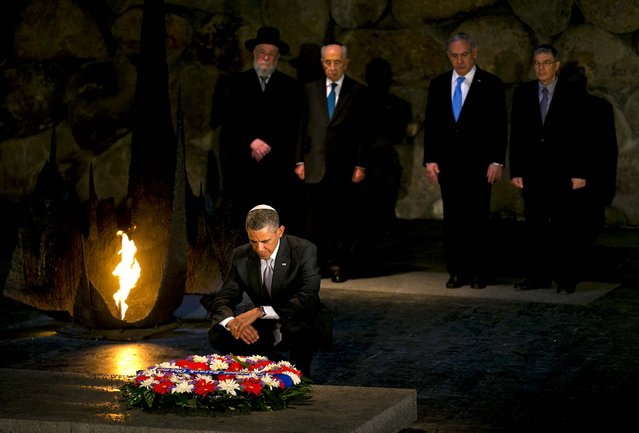 President Barack Obama pauses after laying a wreath at the Yad Vashem Holocaust memorial in Jerusalem, on March 22, 2013, accompanied by (from right) Avner Shalev, chairman of the Yad Vashem Directorate, Israeli Prime Minister Benjamin Netanyahu, Israeli President Shimon Peres and Rabbi Yisrael Meir Lau. (Photo by Doug Mills/The New York Times)