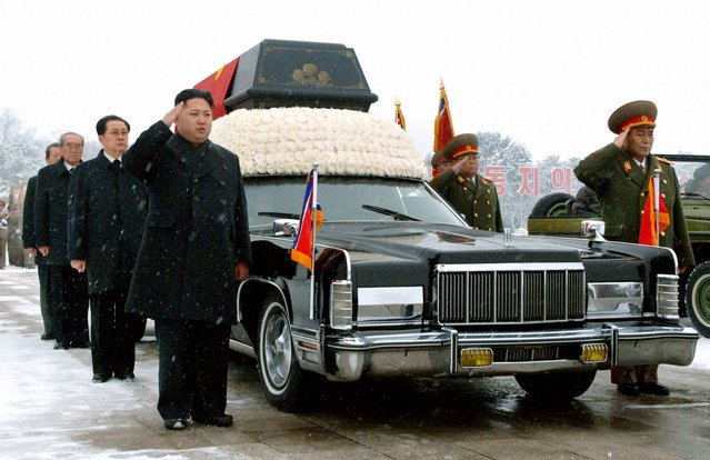 """North Korea's new leader Kim Jong Un (4th from left) salutes as he and his uncle Jang Song-thaek (3rd from left) accompany the hearse carrying the coffin of late North Korean leader Kim Jong Il during his funeral procession in Pyongyang, on December 28, 2011. North Korea's military staged a huge funeral procession on Wednesday in the snowy streets of the capital Pyongyang for its deceased """"dear leader"""", Kim Jong Il, readying a transition to his son, Kim Jong-un. Ri Yong-ho, Chief of General Staff of the Korea People's Army, salutes on the right. (Photo by Reuters/Kyodo)"""