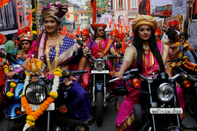 Women dressed in traditional costumes ride motorbikes as they attend celebrations to mark the Gudi Padwa festival, the beginning of the New Year for Maharashtrians, in Mumbai, India March 18, 2018. (Photo by Danish Siddiqui/Reuters)