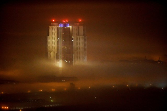 Buildings are seen as fog blankets the city of Skopje, Macedonia October 28, 2020. Skopje high air pollution in winter months made its residents more vulnerable to respiratory diseases including COVID-19. (Photo by Ognen Teofilovskithe/Reuters)