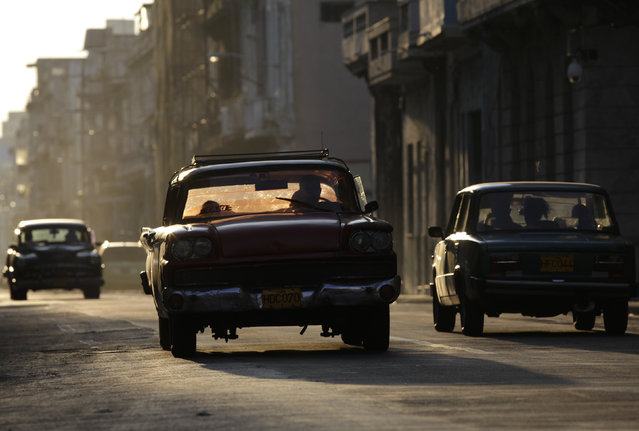 Cars drive down Havana's San Lazaro street, October 3, 2009. (Photo by Enrique De La Osa/Reuters)