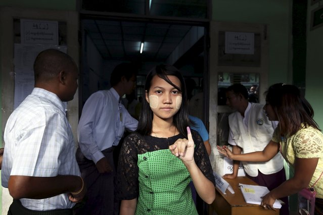 A woman shows her inked finger after casting her ballot during general elections in Yangon November 8, 2015. (Photo by Soe Zeya Tun/Reuters)