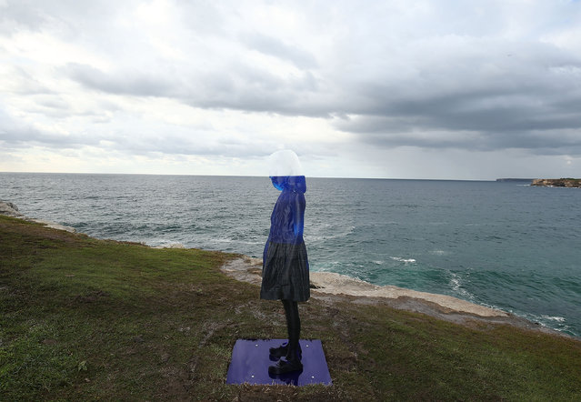 """A sculpture of a young girl is seen during """"Sculpture By The Sea"""" at Tamarama on October 20, 2016 in Sydney, Australia. (Photo by Mark Metcalfe/Getty Images)"""