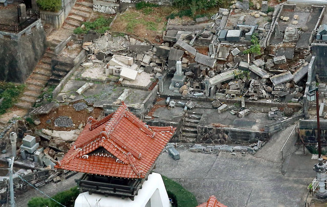 This aerial photo shows fallen tomb stones scattered at a cemetery following an earthquake in Kurayoshi, Tottori prefecture, western Japan, Friday, October 21, 2016. A powerful earthquake with a preliminary magnitude of 6.6 struck western Japan on Friday, toppling shelves and knocking out power to thousands of homes. There was no risk of a tsunami. (Photo by Kyodo News via AP Photo)