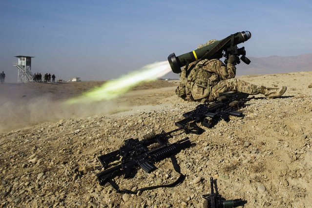 A U.S. soldier from Dragon Troop of the 3rd Cavalry Regiment fires a Javelin missile system during their first training exercise of the new year near operating base Gamberi in the Laghman province of Afghanistan January 1, 2015. (Photo by Lucas Jackson/Reuters)