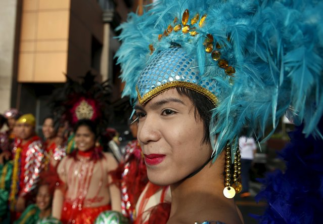 A Filipino transgender woman wears a headdress during a World Aids day celebration in Manila, Philippines, December 1, 2015. (Photo by Erik De Castro/Reuters)