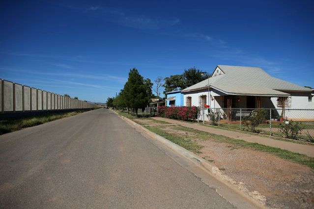 Residential homes are seen next to the fence that borders Mexico, in Douglas, Arizona, United States, October 10, 2016. (Photo by Mike Blake/Reuters)