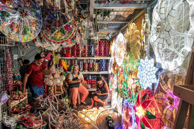A stall packed with Christmas decorations and lanterns at a market in the city Manila, Philippines on December 9, 2020. (Photo by Xinhua News Agency/Rex Features/Shutterstock)
