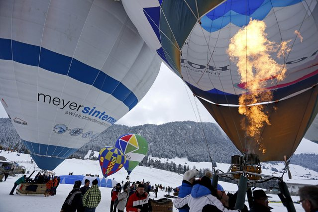 A pilot inflates his balloon before the 37th International Hot Air Balloon Week in Chateau-d'Oex, January 24, 2015. (Photo by Pierre Albouy/Reuters)