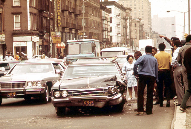 A traffic accident on a crowded street in Harlem, in May of 1973. (Photo by Chester Higgins/NARA via The Atlantic)
