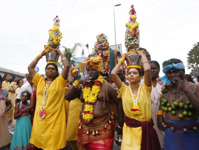 Hindu devotees participate in a pilgrimage to the Batu Caves temple during Thaipusam in Kuala Lumpur February 3, 2015. (Photo by Olivia Harris/Reuters)