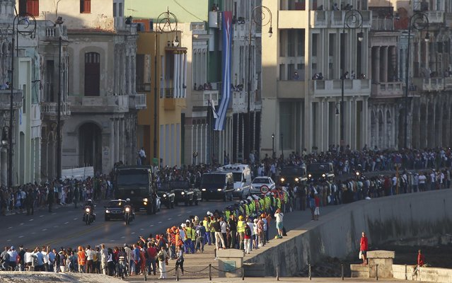 Military vehicles transporting the ashes of Cuba's late President Fidel Castro pass along the Malecon seawall at the start of a three-day journey to the eastern city of Santiago, in Havana, Cuba, November 30, 2016. (Photo by Carlos Garcia Rawlins/Reuters)