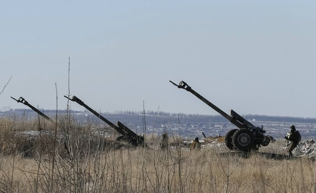 Cannons of the Ukrainian armed forces are seen at their positions near Debaltseve, eastern Ukraine, February 17, 2015. (Photo by Gleb Garanich/Reuters)