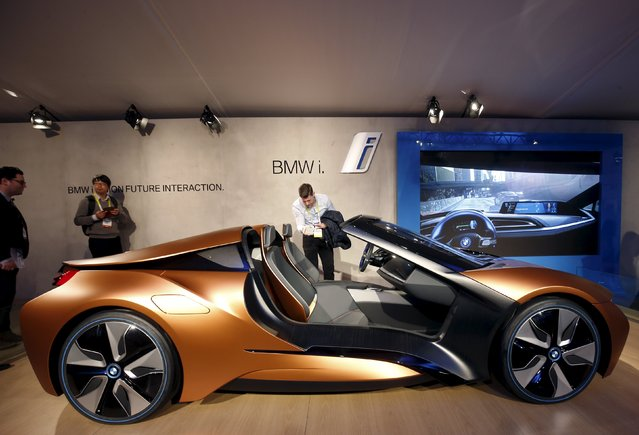 People look over the BMW i Vision Future Interaction concept car during the 2016 CES trade show in Las Vegas, Nevada January 7, 2016. (Photo by Steve Marcus/Reuters)