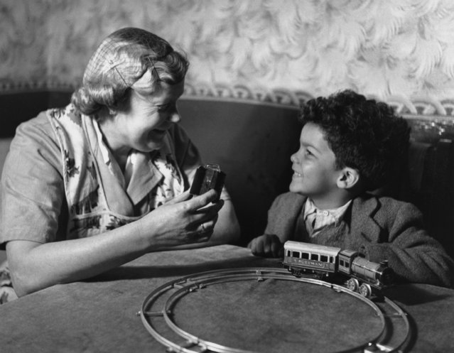 A young boy playing with a train set at his home in the Cardiff docklands, 22nd April 1950. An ethnic mix of Arab, Somali, West African, West Indian and Greek families make up the population of this area, known as Bute Town or Tiger Bay. (Photo by Bert Hardy/Picture Post/Getty Images)