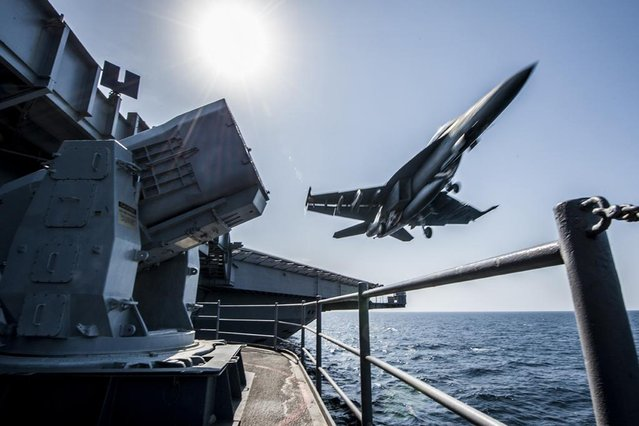 A U.S. Navy F/A-18 launches from the USS Carl Vinson in this undated handout picture released November 1, 2014.  U.S.-led air strikes hit Islamic State positions around Kobani earlier in the day in an apparent effort to pave the way for the heavily-armed Kurdish contingent to enter. (Photo by US Navy/Handout via Reuters)