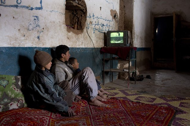 Children watch TV in their house in Tilmi village in the High Atlas region of Morocco February 13, 2015. (Photo by Youssef Boudlal/Reuters)