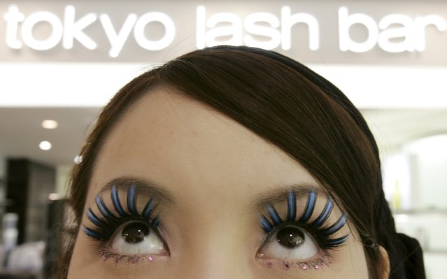 An employee of Japan's Shu Uemura Cosmetics displays false eyelashes at a store in the Omotesando district in Tokyo in this May 17, 2007 file photo. Japan is expected to report retail sales data for December this week. (Photo by Yuriko Nakao/Reuters)