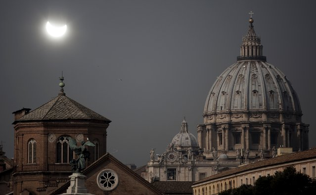 A partial solar eclipse is seen over St.Peter's Basilica in Rome March 20, 2015. (Photo by Yara Nardi/Reuters)
