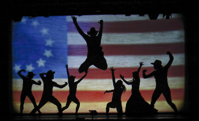 """In this photo taken on Tuesday, December 20, 2016, dancers of the U.S. company """"Catapult"""" perform during their show """"Magic Shadows"""", in Milan, Italy. (Photo by Luca Bruno/AP Photo)"""