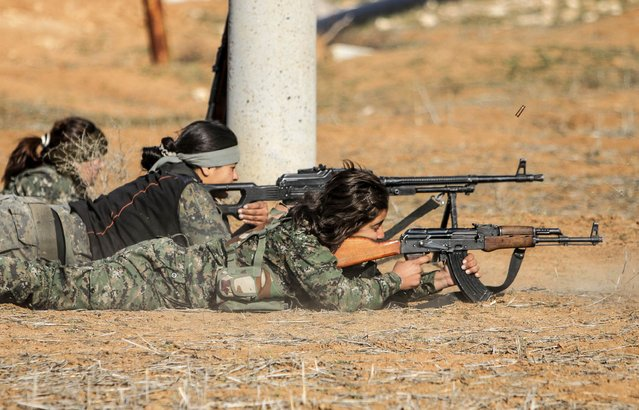 Female fighters of the Kurdish People's Protection Units (YPG) participate in a military training in the western countryside of Ras al-Ain January 25, 2015. (Photo by Rodi Said/Reuters)