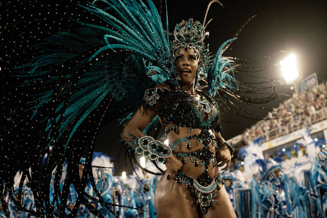 Revellers of Unidos da Tijuca samba school perform during the first night of the carnival parade at Sambadrome in Rio de Janeiro, Brazil on February 8, 2016. (Photo by Yasuyoshi Chiba/AFP Photo)