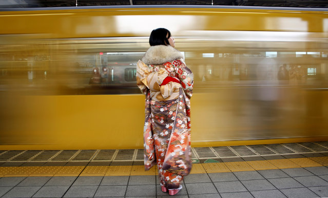 A Japanese woman wearing a kimono waits for her train after Coming of Age Day celebration ceremony in Tokyo, Japan January 9, 2017. (Photo by Kim Kyung-Hoon/Reuters)