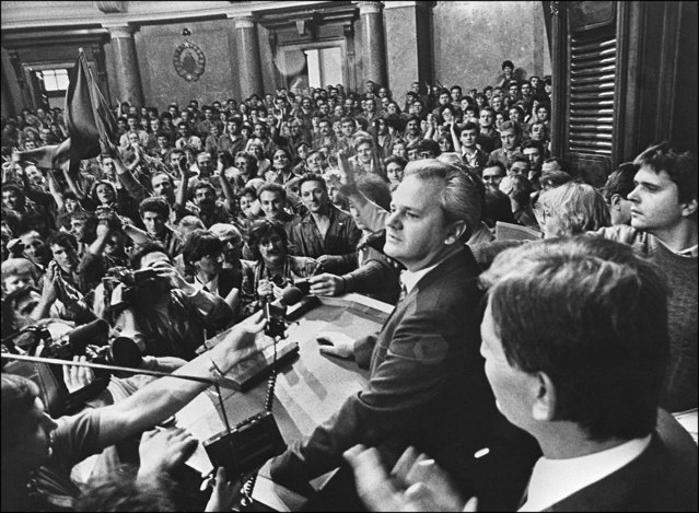 Serbia's communist Party leader Slobodan Milosevic meets with workers, 06 October 1988 inside the federal parliament in Belgrade. (Photo by STF/TANJUG/AFP Photo)