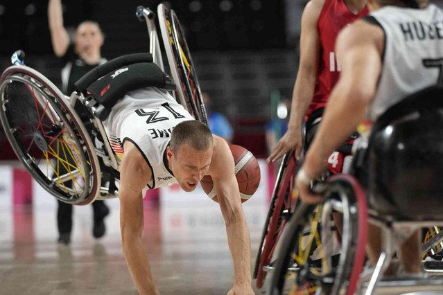 Germany's Thomas Boehme falls during a wheelchair basketball men's preliminary round match against Iran at the Tokyo 2020 Paralympic Games, Monday, August 30, 2021, in Tokyo, Japan. (Photo by Shuji Kajiyama/AP Photo)