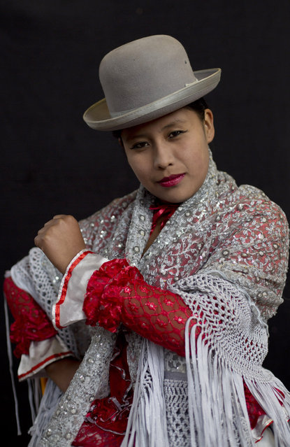 Young cholita wrestler Dona Chevas strikes a pose for a portrait before competing in the ring in El Alto, Bolivia, Sunday, February 10, 2019. A new generation of about 50 young women like Dona Chevas, 16, are training at three schools to take up the sport. (Photo by Juan Karita/AP Photo)