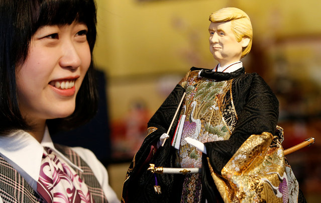 An employee of Japanese doll-maker Kyugetsu Inc poses with a doll depicting U.S. President Donald Trump, as part of a traditional set of Japanese ornamental hina dolls used in Japan to celebrate Girls' Day, at the company's main shop in Tokyo, Japan, January 26, 2017. (Photo by Toru Hanai/Reuters)