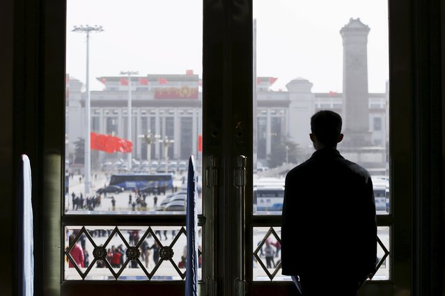 A security officer stands guard at the Great Hall of the People during the opening session of the National People's Congress (NPC) in Beijing, China March 5, 2016. (Photo by Aly Song/Reuters)