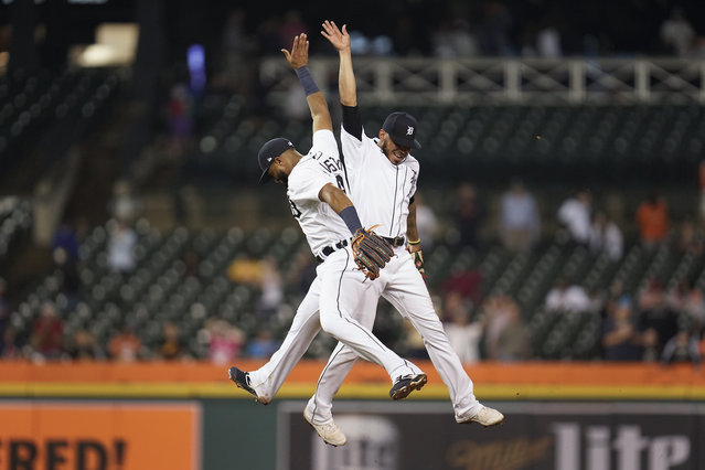 Detroit Tigers' Willi Castro, left, and Harold Castro, right, celebrate after the final out in the ninth inning of a baseball game against the Chicago White Sox in Detroit, Monday, September 20, 2021. Detroit won 4-3. (Photo by Paul Sancya/AP Photo)