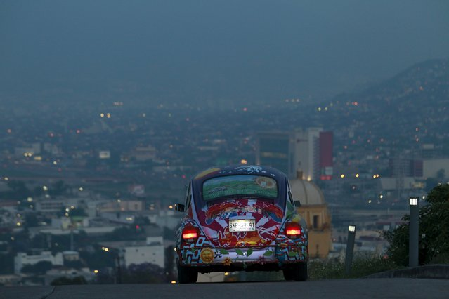 """Rene Penia drives his VW Beetle 1995, locally called """"Vocho"""", through the streets of Monterrey April 22, 2015. (Photo by Daniel Becerril/Reuters)"""