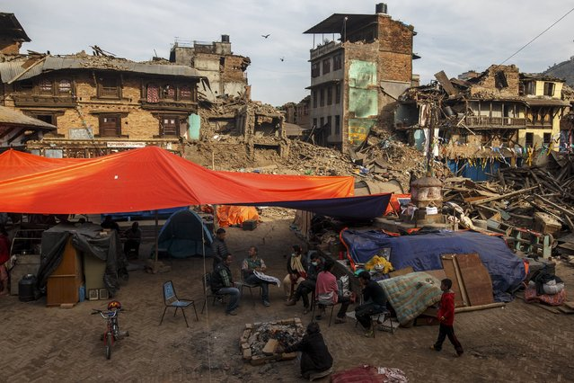 Earthquake survivors gather next to their makeshift shelters, near collapsed houses in Sankhu, on the outskirts of Kathmandu, Nepal, May 5, 2015. (Photo by Athit Perawongmetha/Reuters)