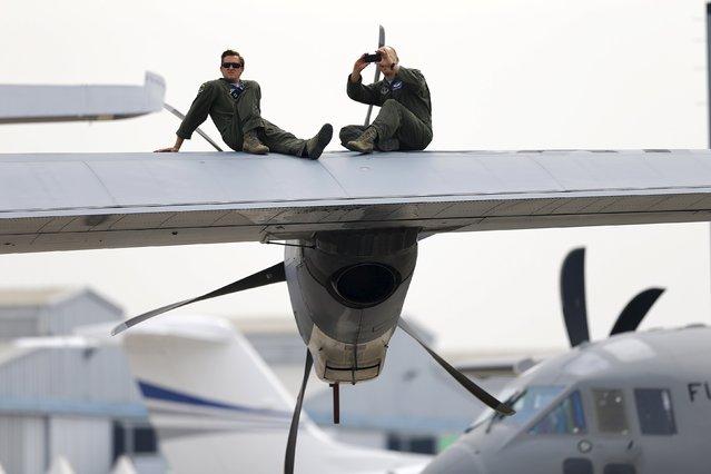 U.S. Air Force members take a break ahead of the International Air and Space Fair (FIDAE) at Santiago international airport, March 28, 2016. (Photo by Ivan Alvarado/Reuters)